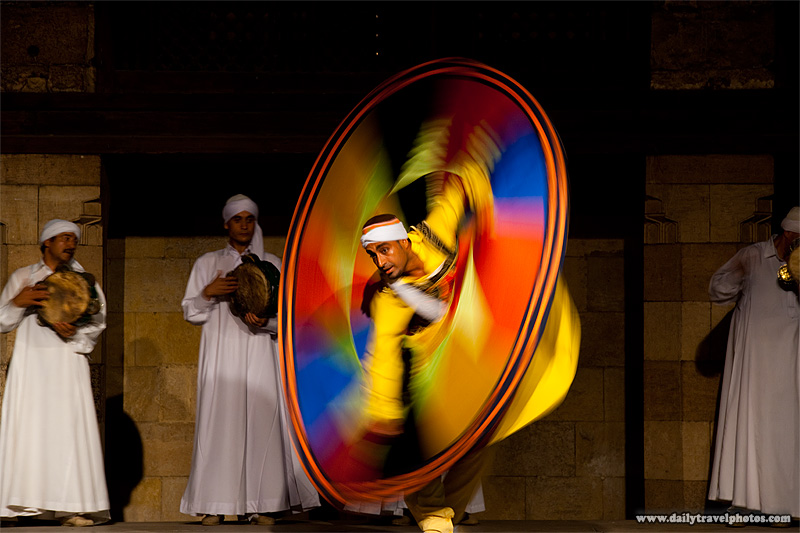 Whirling dervish performance in old Islamic Cairo twisting in technicolor - Cairo, Egypt - Daily Travel Photos