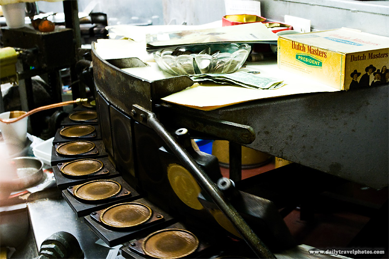 Conveyor fortune cookie machine in Chinatown - San Francisco, California, USA - Daily Travel Photos