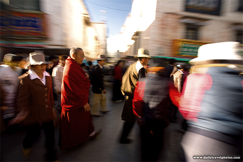Tibetan pilgrims walk around the Barkhor - Lhasa, Tibet - Daily Travel Photos