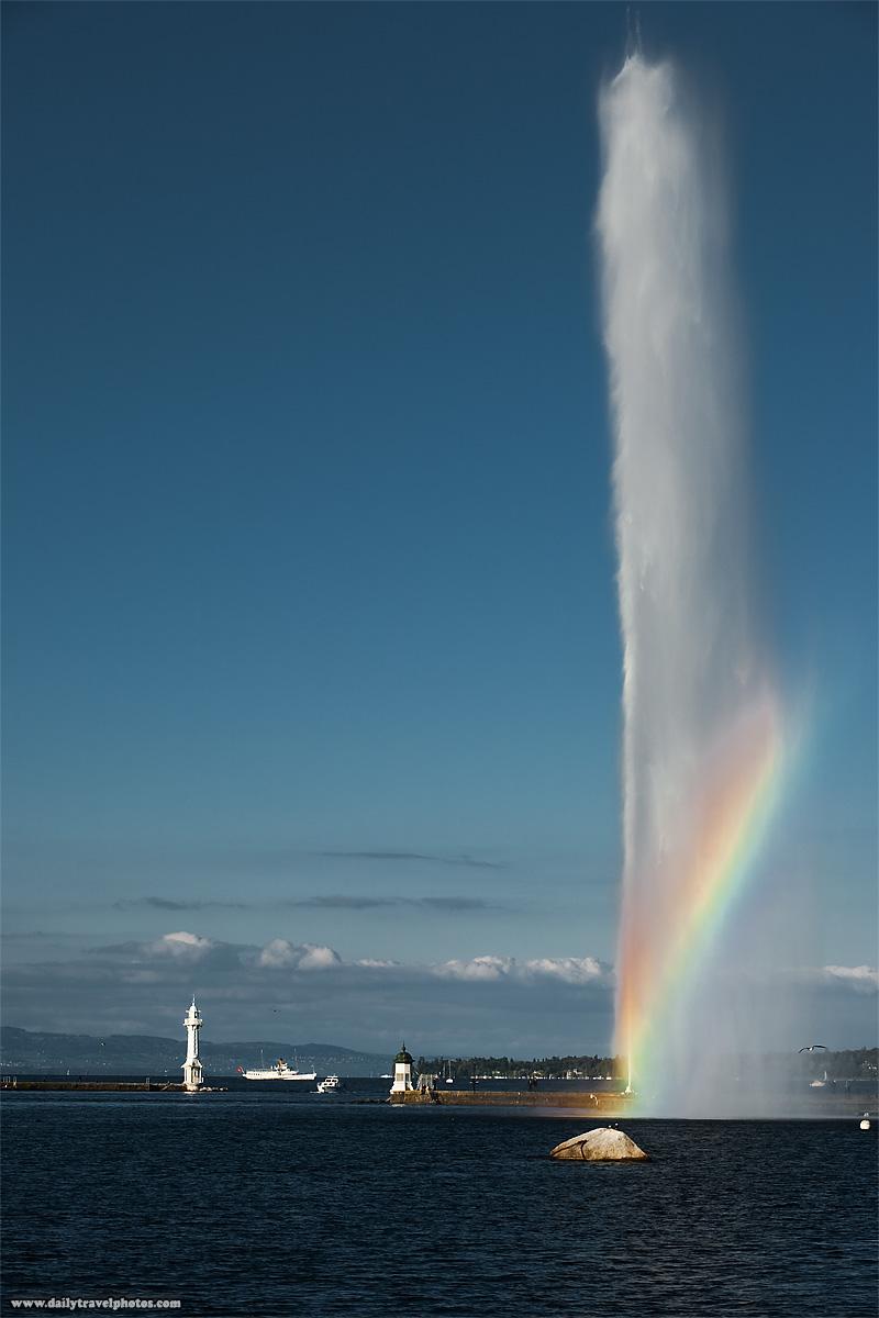 A rainbow at Jet de l'eau famous water fountain on Lake Geneva - Geneva, Switzerland - Daily Travel Photos