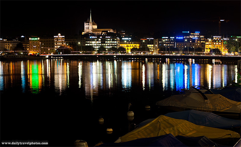 Downtown Geneva and St. Pierre's Cathedral in old town reflected on Lake Geneva - Geneva, Switzerland - Daily Travel Photos