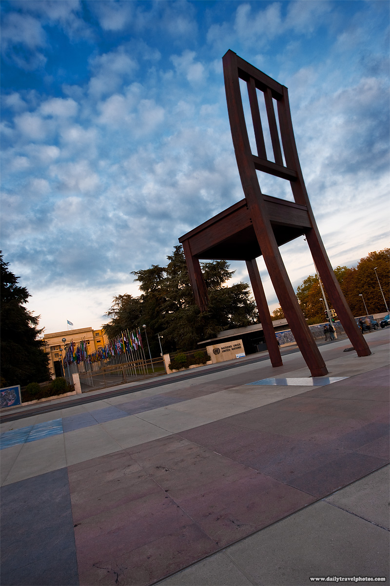 Closeup of the broken chair art installation at UN plaza at the European headquarters of the United Nations - Geneva, Switzerland - Daily Travel Photos