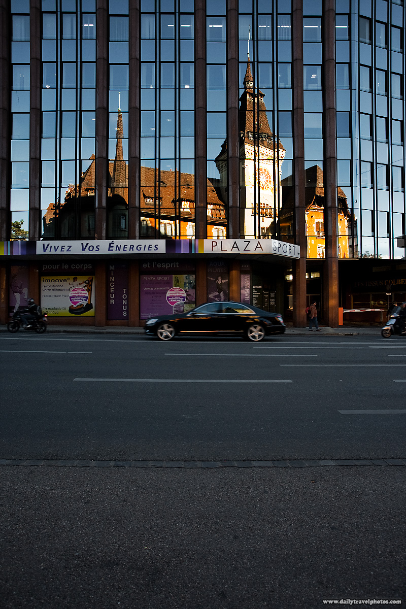 UGS building reflected by a modern office building - Geneva, Switzerland - Daily Travel Photos