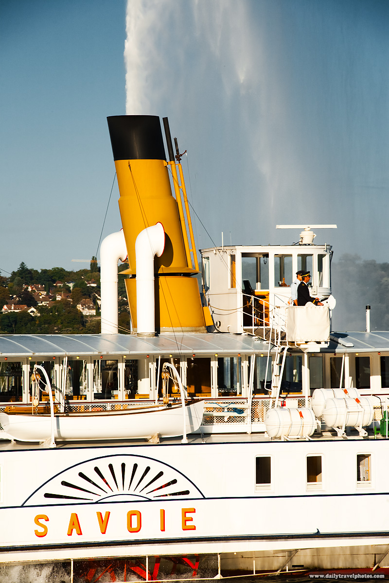 Savoie dinner cruise ship appears to spray water from its smokestack on Lake Geneva - Geneva, Switzerland - Daily Travel Photos