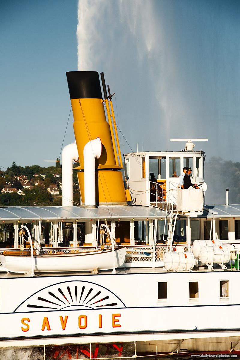 Savoie dinner cruise ship appears to spray water from its smokestack on Lake Geneva - Geneva, Switzerland - Daily Travel Photos