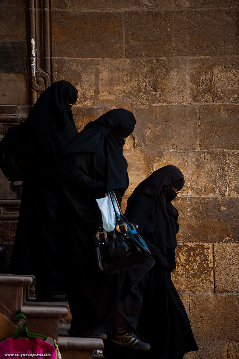 Muslim women in burqas navigate a set of stairs at the Al-Ghouri complex in Islamic Cairo - Cairo, Egypt - Daily Travel Photos