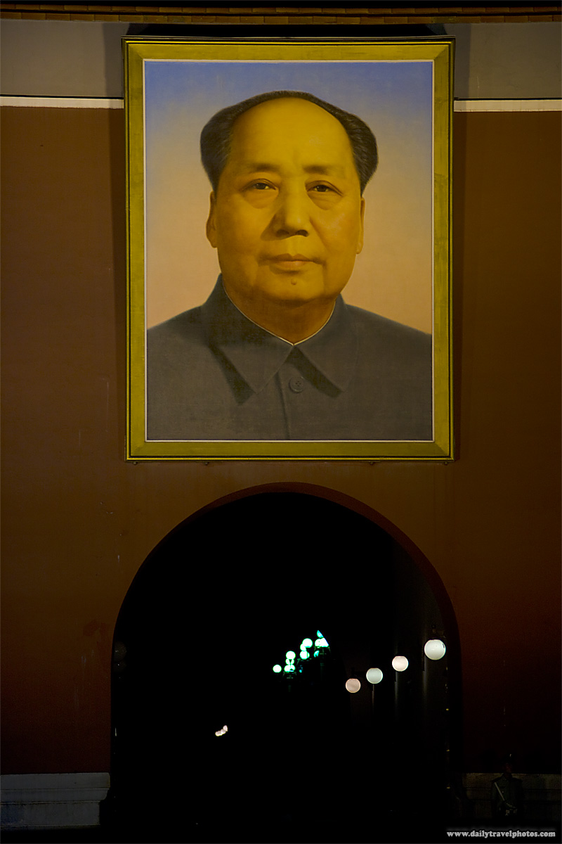 An over-sized portrait of Mao above the tunnel entrance to the Forbidden City - Beijing, China - Daily Travel Photos