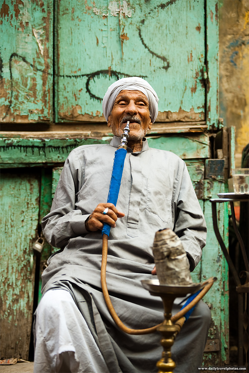 An Egyptian man puffs on a sheesha at a street-side cafe in Islamic Cairo - Cairo, Egypt - Daily Travel Photos