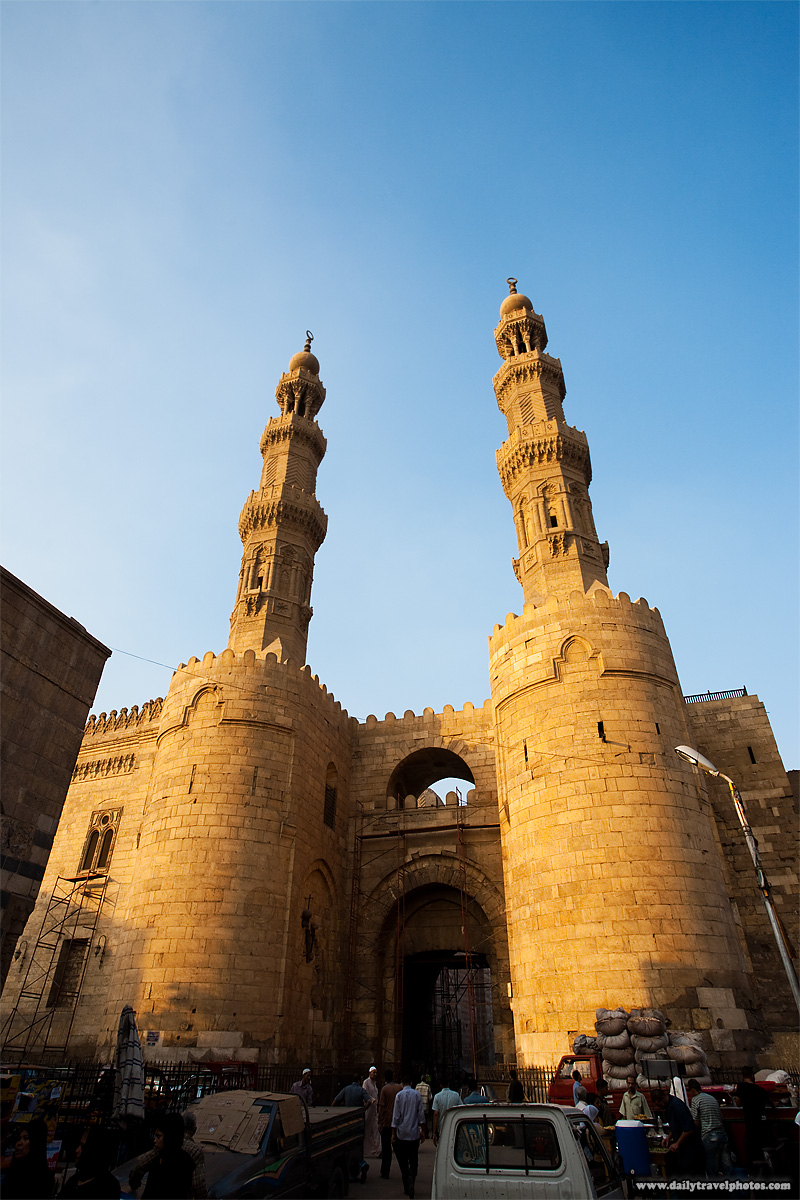Egyptian bustle at the base of the Bab Zuweila Gate in Islamic Cairo - Cairo, Egypt - Daily Travel Photos
