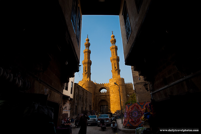 Bab Zuweila framed by the entrance to the Tentmakers' Bazaar - Cairo, Egypt - Daily Travel Photos