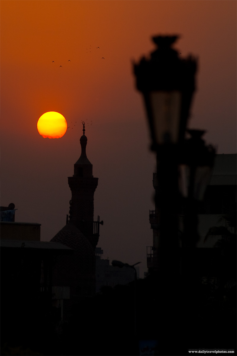 A minaret in Islamic Cairo at sunset - Cairo, Egypt - Daily Travel Photos