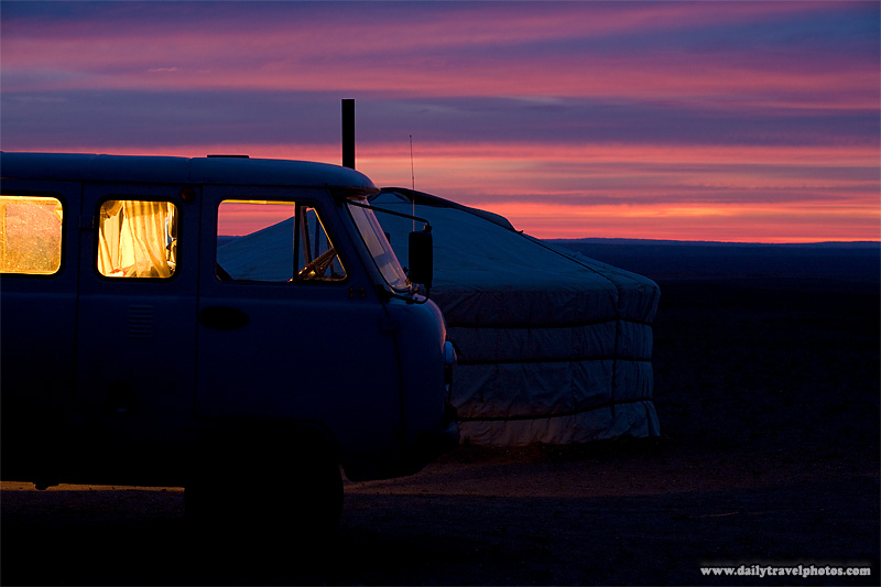A van outside a ger at sunset on the Mongolia plains - Gobi Desert, Mongolia - Daily Travel Photos