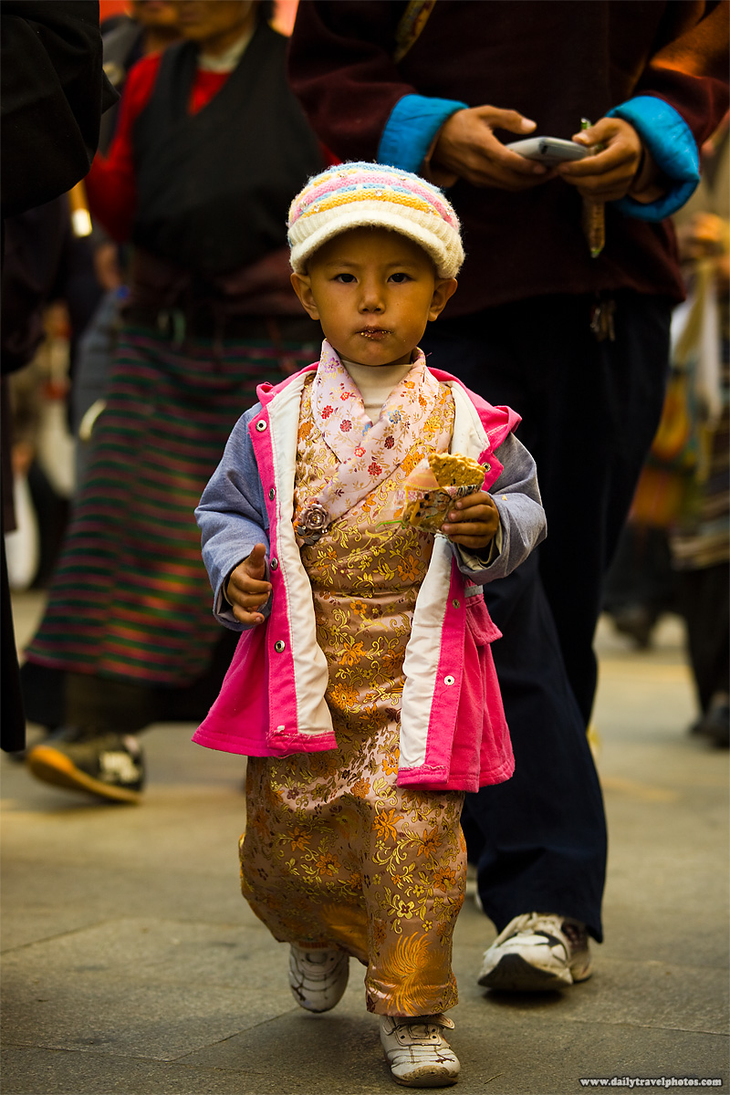 A young Tibetan girl dressed in beautiful traditional clothes - Lhasa, Tibet - Daily Travel Photos