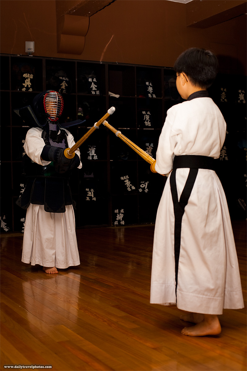 Two young Korean boys square off in a Kendo class - Seoul, South Korea - Daily Travel Photos