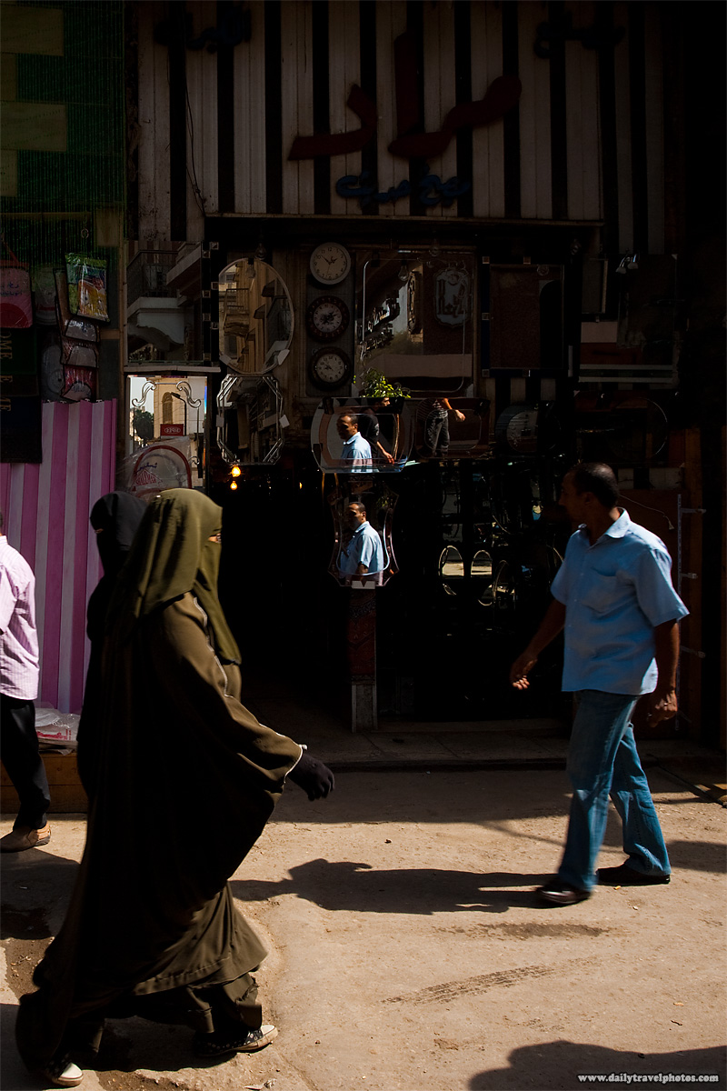 An Egyptian man's reflection in a mirror in Islamic Cairo - Cairo, Egypt - Daily Travel Photos