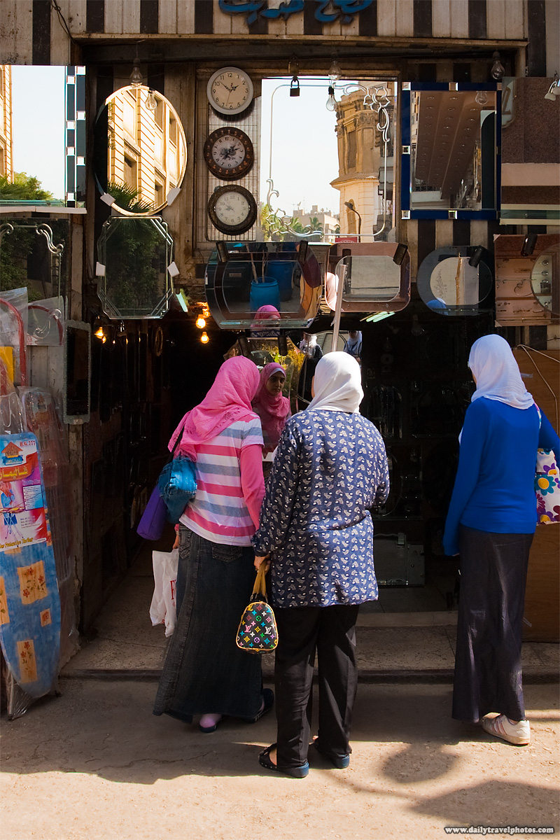 Egyptian women shop for a mirror in Islamic Cairo - Cairo, Egypt - Daily Travel Photos