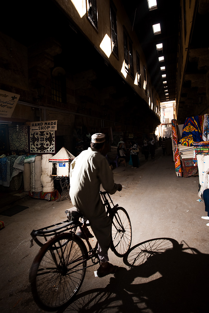 A Muslim man rides his bicycle through the Bazaar of the Tentmakers - Cairo, Egypt - Daily Travel Photos