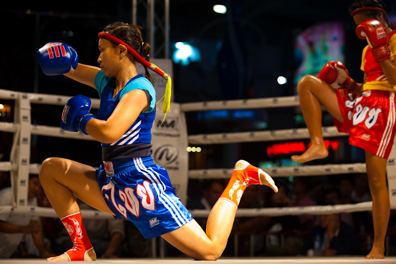 Lady's Kickboxing Wai Khru Ram Muay Thai Opponents Fist Roll - Bangkok, Thailand - Daily Travel Photos
