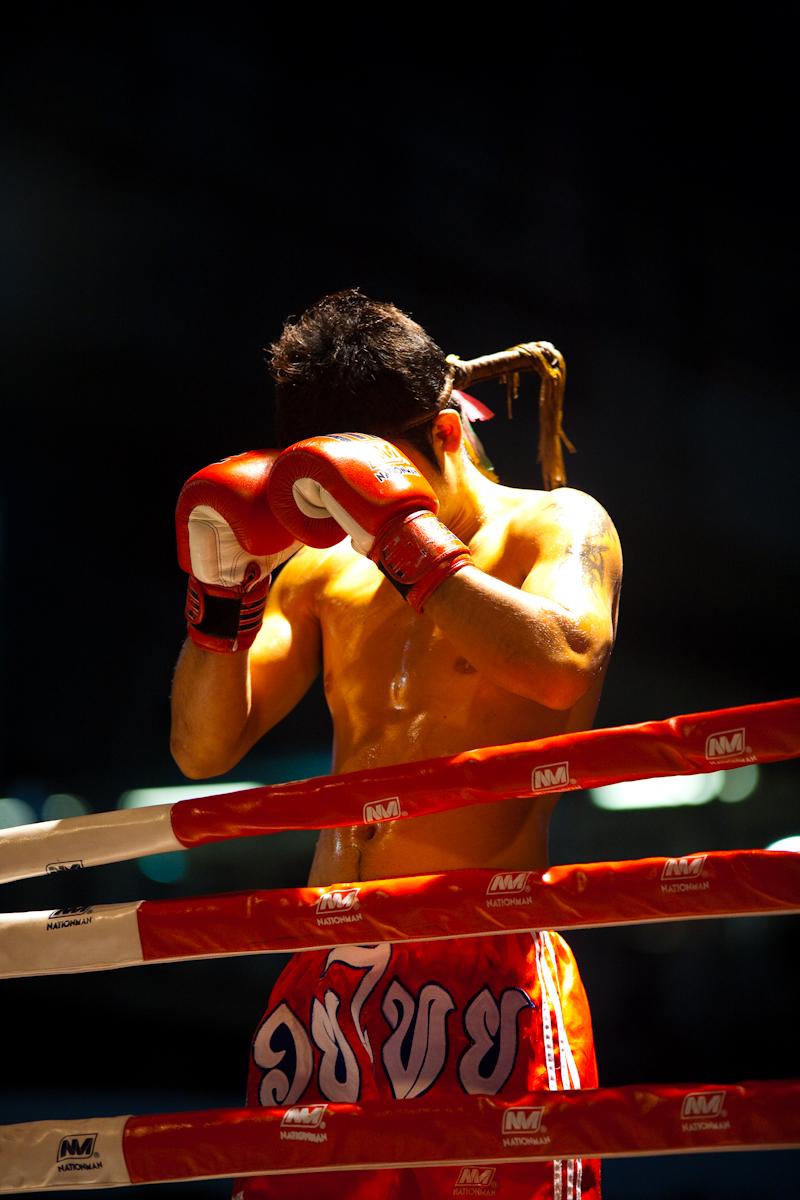 Muay Thai Boxer Praying Ringside Wai Khru Ram Muay - Bangkok, Thailand - Daily Travel Photos