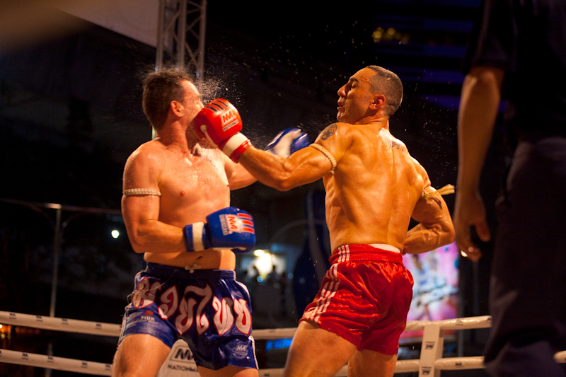 Left Hook Lands Solidly Muay Thai Boxing Ringside - Bangkok, Thailand - Daily Travel Photos