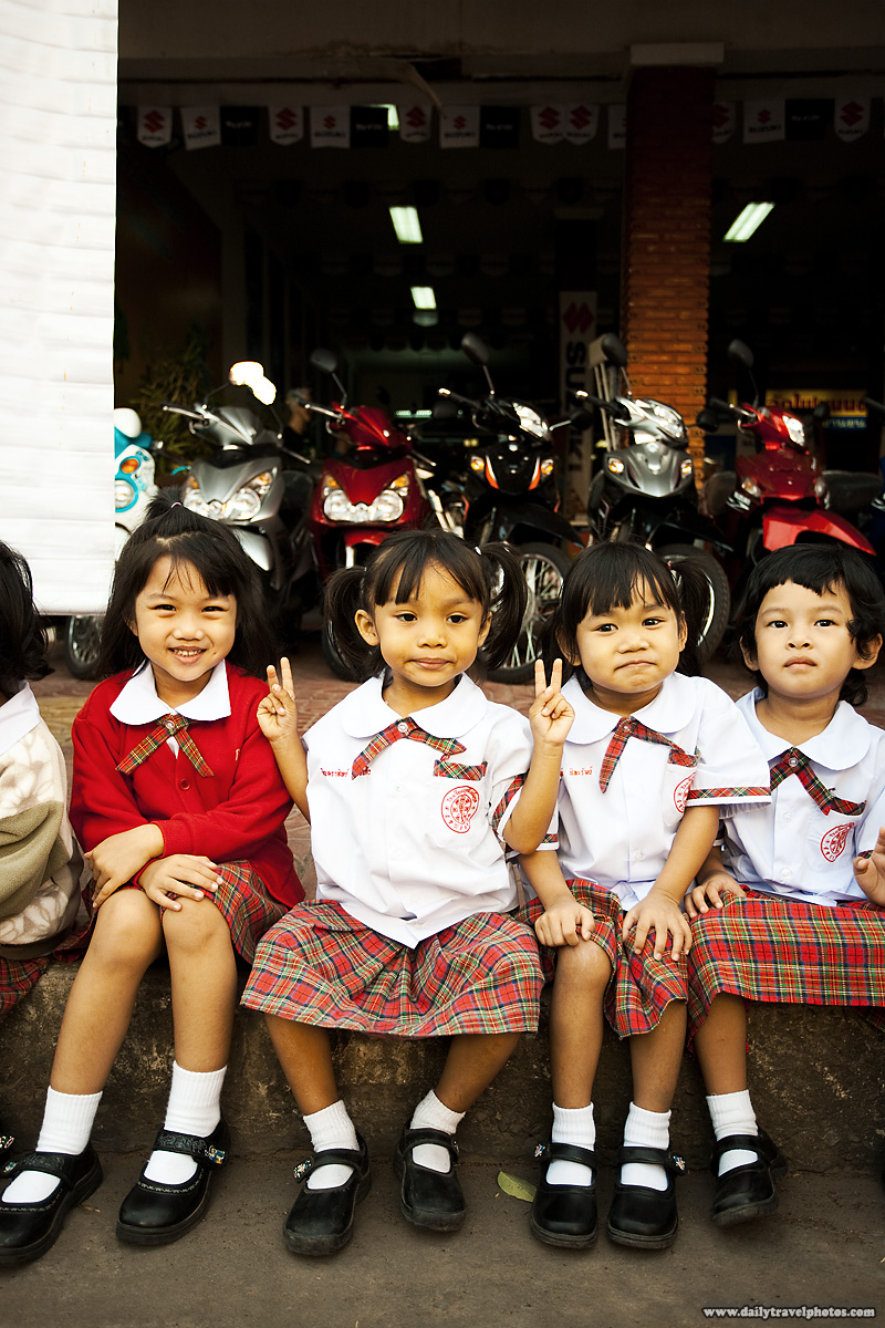 Happy Thai School Children Uniform Waiting On Curb - Surin, Isaan, Thailand - Daily Travel Photos