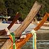 Ribbons Photo: Colorful ribbons hang off the bows of longtail boats.