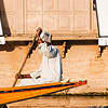 Water Dwellings Photo: A Kashmiri man rows past the shaded windows of a houseboat on Dal Lake.
