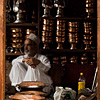 Striking Shopkeeps Photo: A silver and copper goods salesman sits idle on a slow business day.