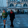 Watering Hole Photo: Two women take an evening stroll on the elevated path connecting Het Steen and a well-housed bistro.