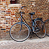 Fittingly Flanders Photo: Bicycles parked outside a traditional brick building.