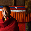 Shawl & Wall Photo: A Buddhist monk stands in a small monastery's courtyard inside the temple complex of Dhankar.