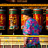 Blurred Buddhists Photo: Tibetan Buddhists spin prayer wheels at a temple (Archived photos on the weekends).