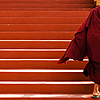 Tardy Trot Photo: A monk is late to the (disputed) 17th Karmapa, His Holiness Ogyen Trinley Dorje's birthday ceremony (archived photos, on the weekends).