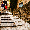 photo: Bouldery Boulevard - Tourists climb down a hilly stone path of Gordes, a picturesque Provencal village.