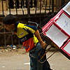 Boy Beast of Burden Photo: A young Egyptian boy struggles to pull a dolly full of merchandise in Islamic Cairo.