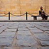 Sweeping Soldier Photo: A street-cleaner rests on a bench in Islamic Cairo.