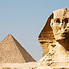 Sphinx Perspective Photo: The head of the Sphinx and Pyramid of Menkaure, the furthest of the three major Giza pyramids.