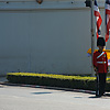 photo: Thai Royal Guard - A Thai Royal guard near the wall of the National Palace awaits the arrival of the King of Thailand.