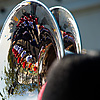 Tin Soldiers Photo: Members of the marching band are nicely reflected in the head of a sousaphone.