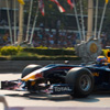 Formula One Race Car Photo: Mark Webber, part of Red Bull's Formula One team, whips past the crowd at ludicrous speed.