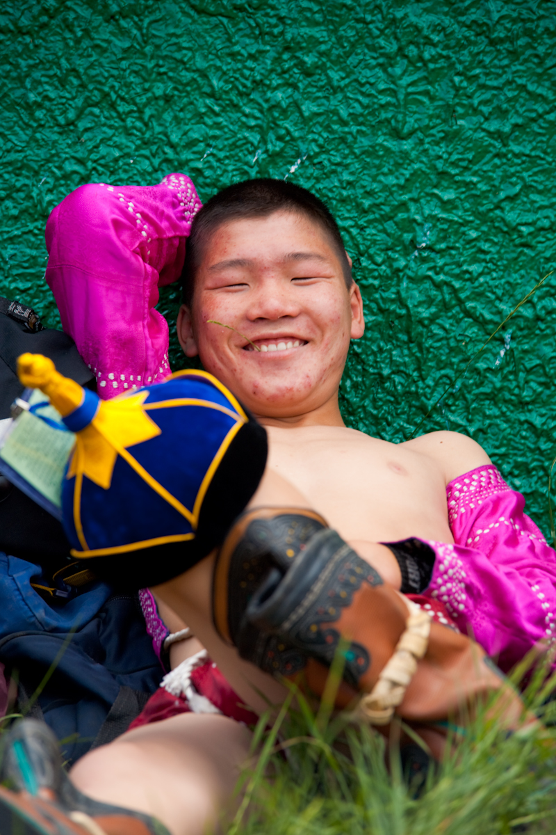 Smiling Mongolian Nadaam Festival Wrestler Relaxing - Ulaan Baatar, Mongolia - Daily Travel Photos