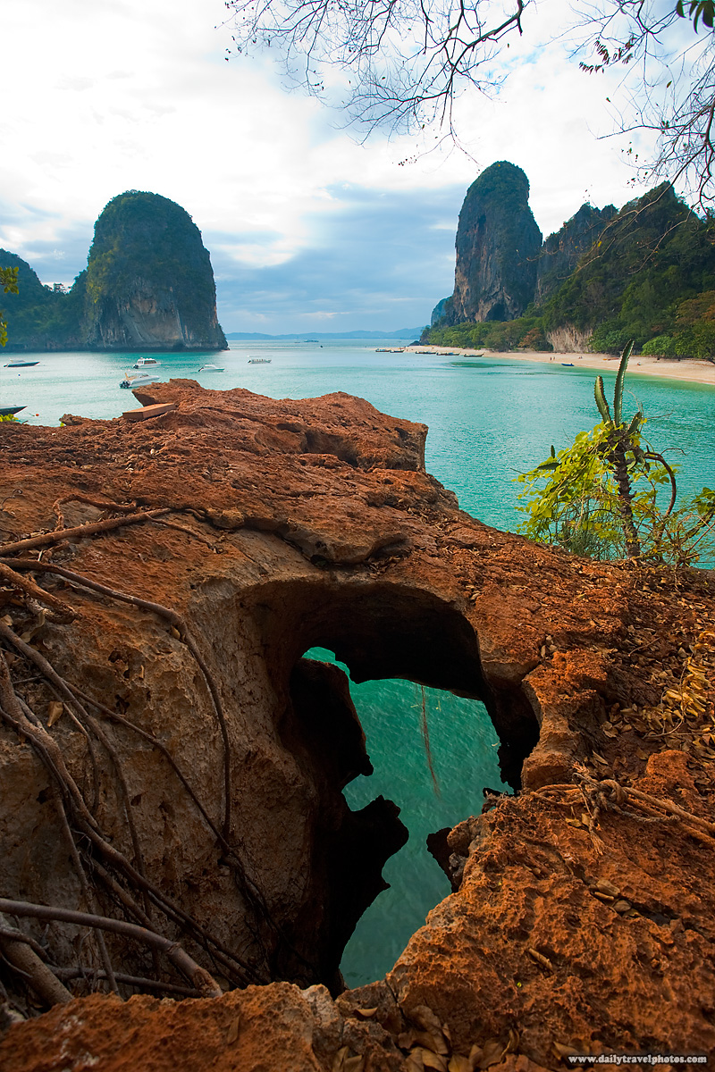 Cliff Phranom Beach Hole Ocean - Railay, Thailand - Daily Travel Photos