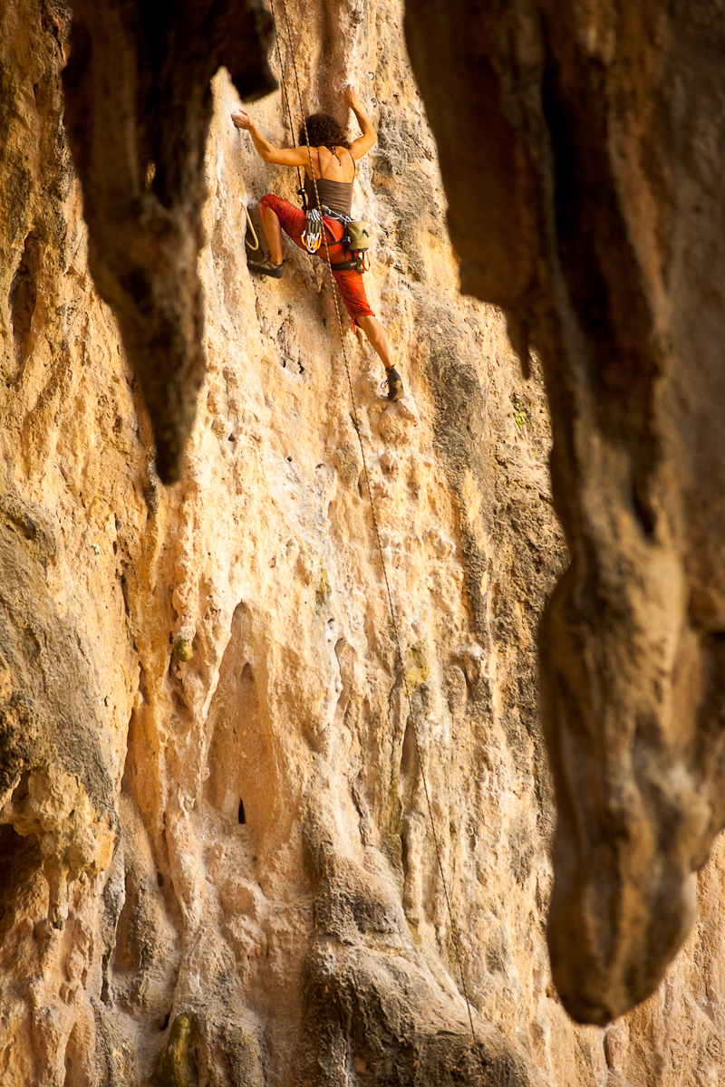 Female Rock Climber Framed Stalactites - Railay, Thailand - Daily Travel Photos