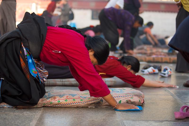 Tibetan Woman Praying Prostrating Jokhang Temple - Lhasa, Tibet - Daily Travel Photos