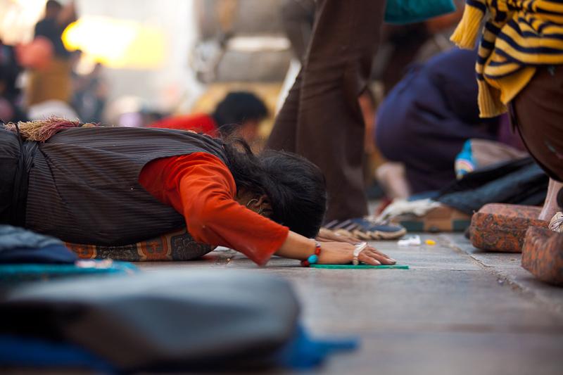 Tibetan Woman Full Prostration Jokhang Temple - Lhasa, Tibet - Daily Travel Photos