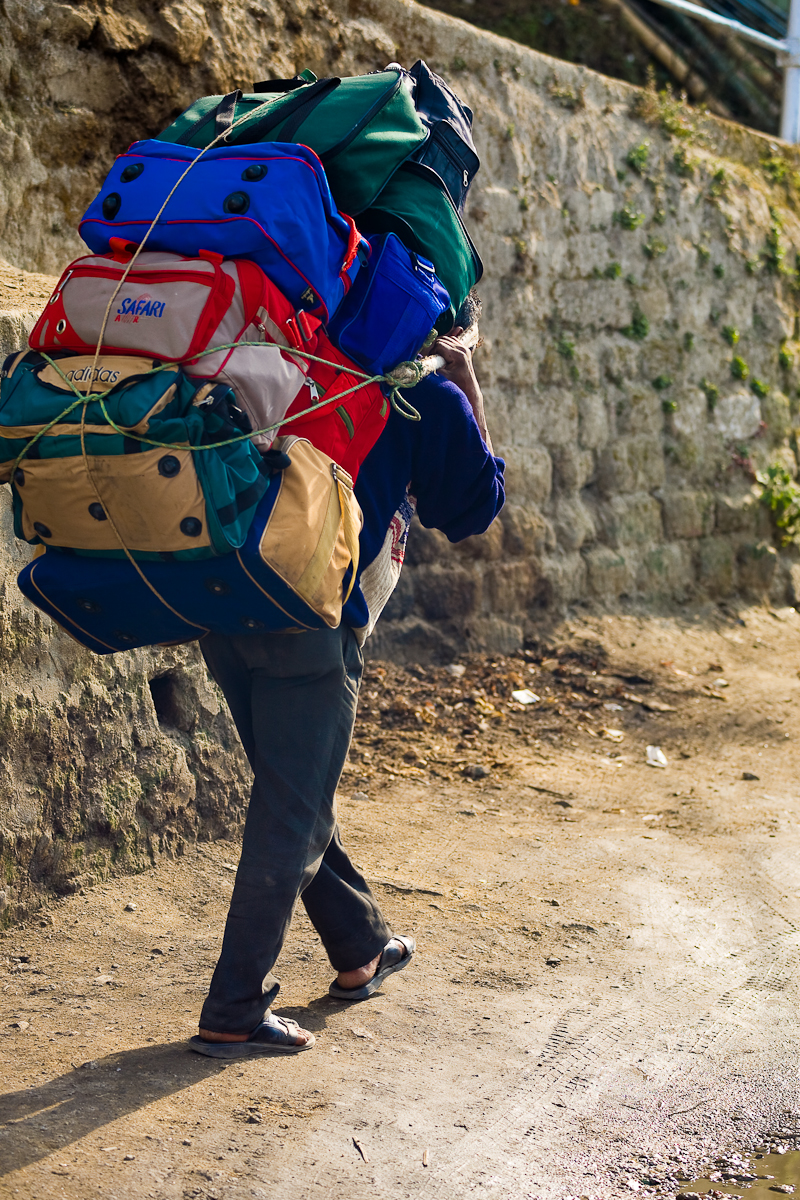 Indian Porter Carrying Many Heavy Bags - Darjeeling, West Bengal, India - Daily Travel Photos
