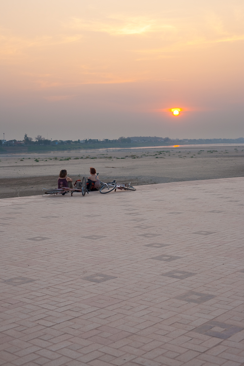 Foreign Tourists Mekong River Sunset Bicycles - Vientiane, Laos - Daily Travel Photos