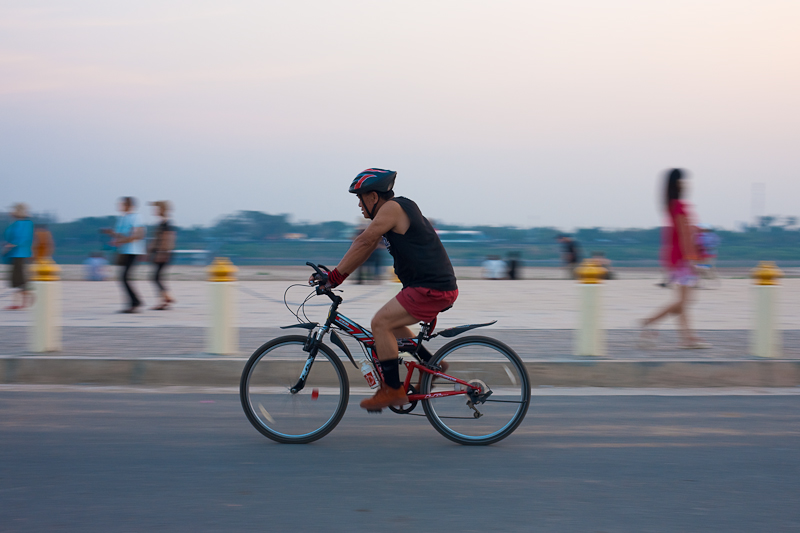 Bicyclist Promenade Mekong River Laotian Evening - Vientiane, Laos - Daily Travel Photos