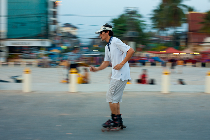 Rollerblade Laotian Promenade Blur Motion Pan - Vientiane, Laos - Daily Travel Photos