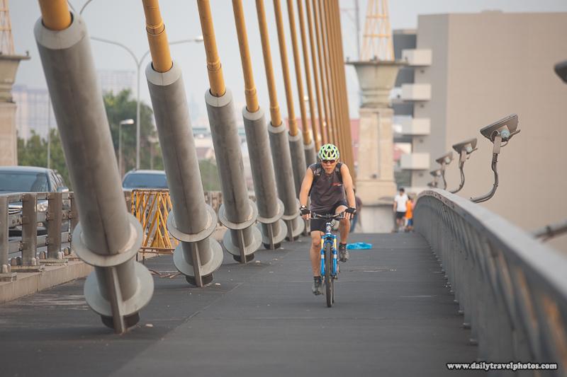 Pre-Processed Version Bicyclist Rama VIII Bridge Evening Repetition Cables - Bangkok, Thailand - Daily Travel Photos